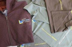 Arbeitskleidung im Transferdruck